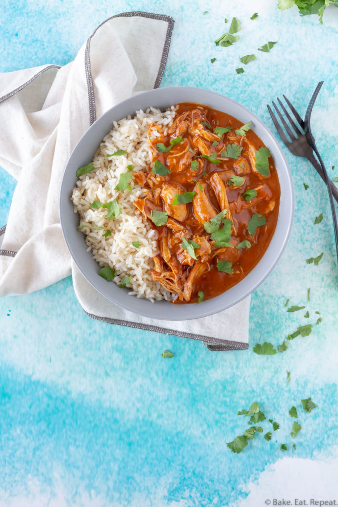 A bowl of Indian butter chicken and rice.