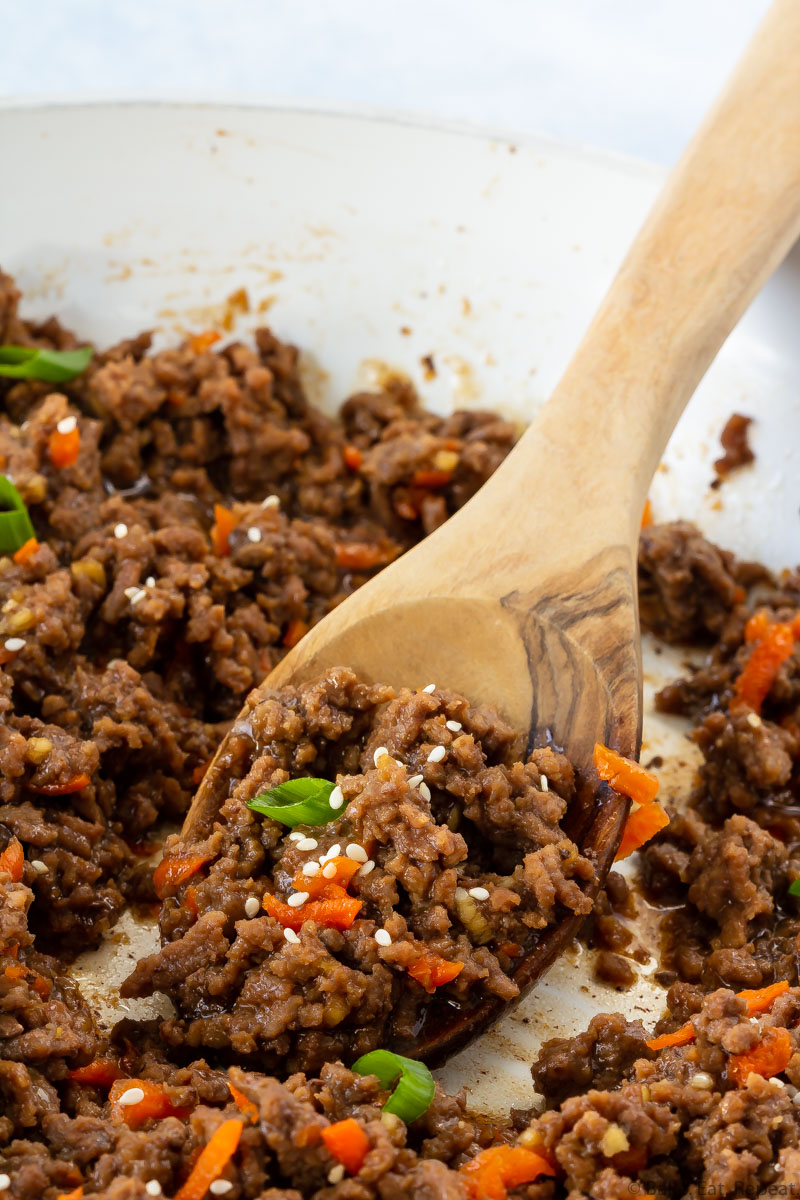 Korean ground beef with a spoon in a skillet.