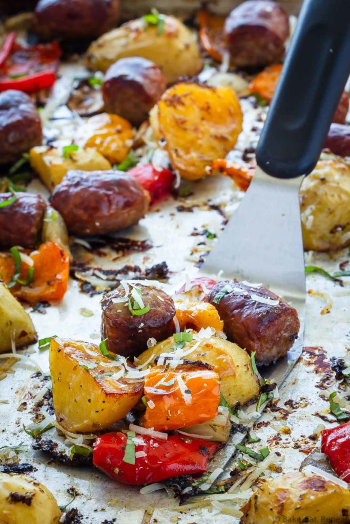Italian sausage, peppers, potatoes, and onions baked on a sheet pan